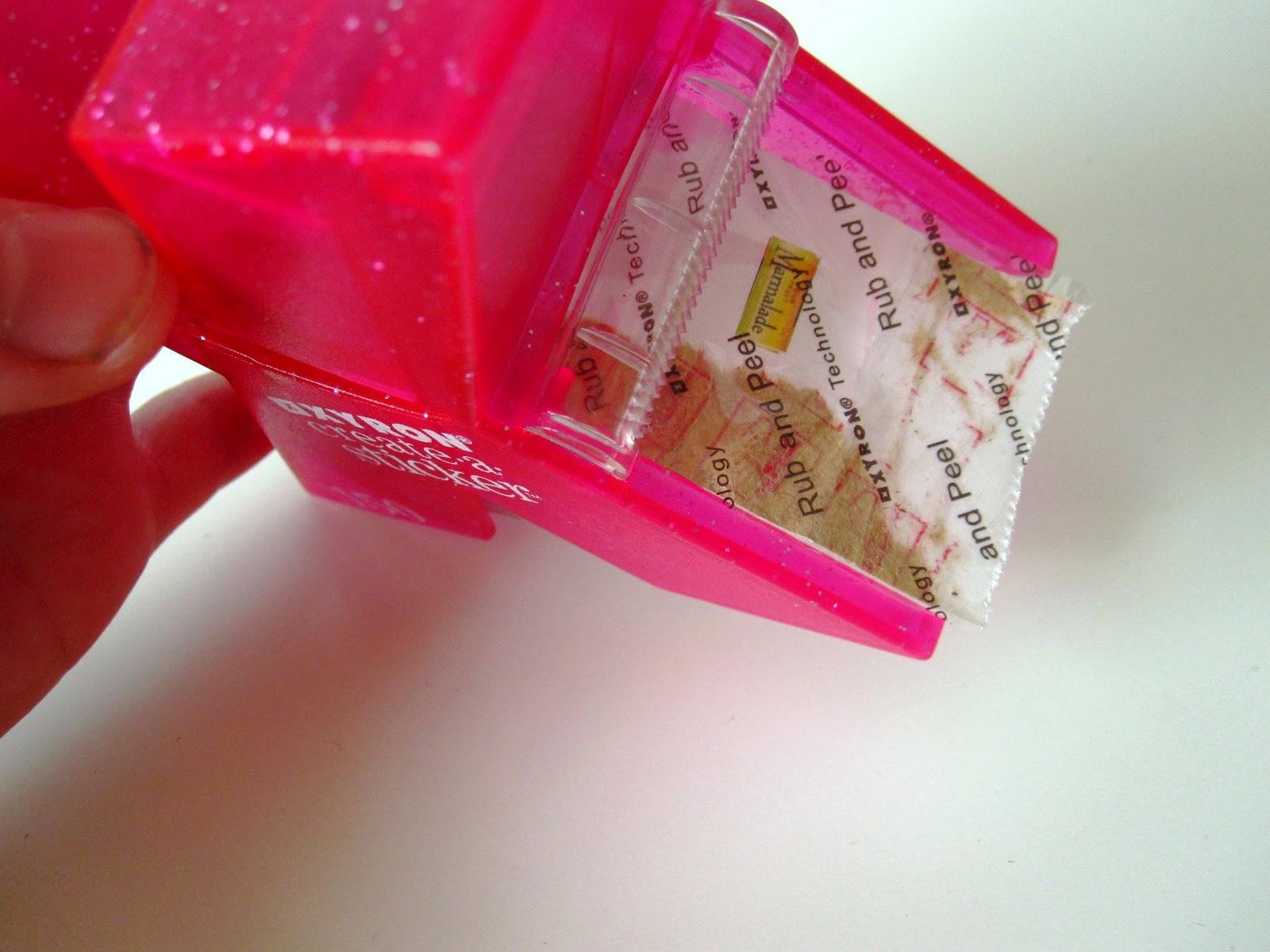 A Xyron 150 Create-a-Sticker machine with a dolls' house miniature marmalade jar label turned into a sticker.