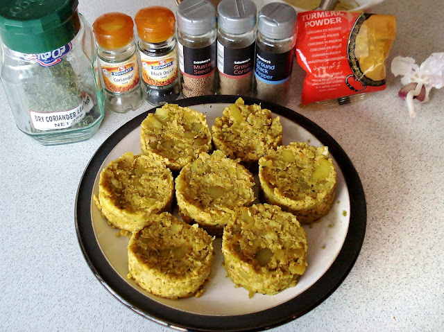 Uncooked Falafel Burgers with herbs and spices