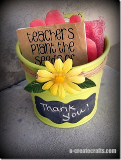 yellow bucket with flower and chalkboard label that says thank you bucket filled with gardening supplies
