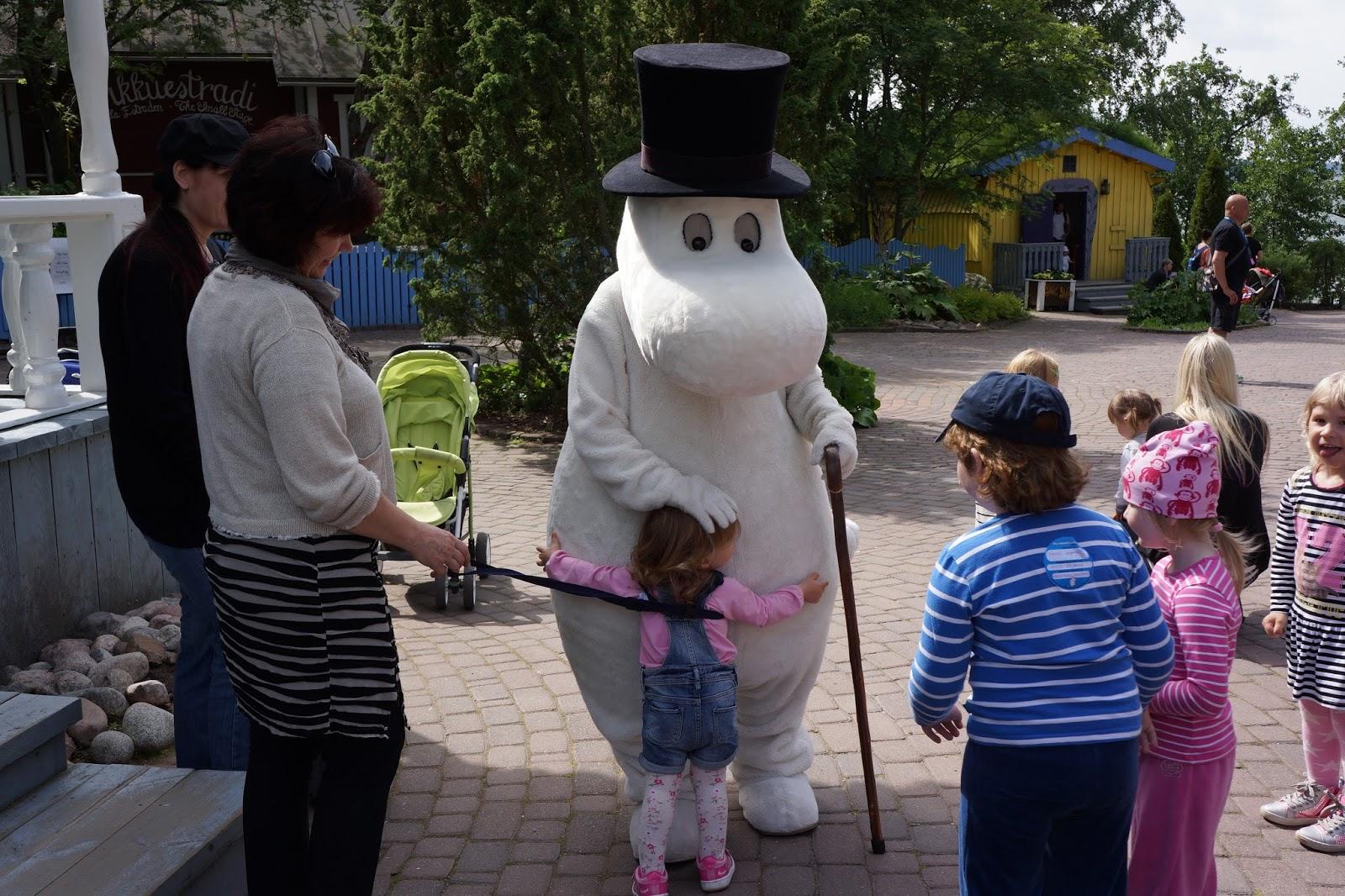 moomin world finland hugging moominpappa