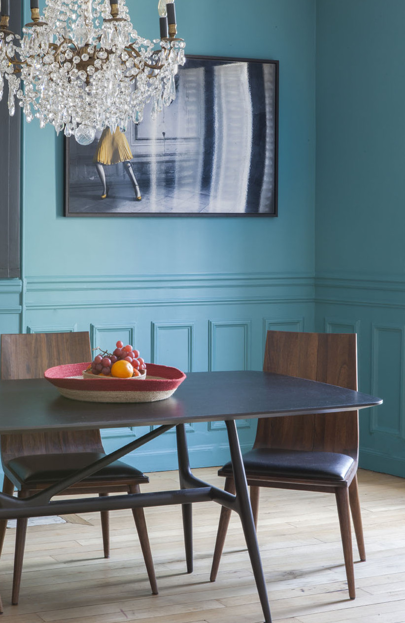 paris apartment with teal color, mid century modern furniture, dining table