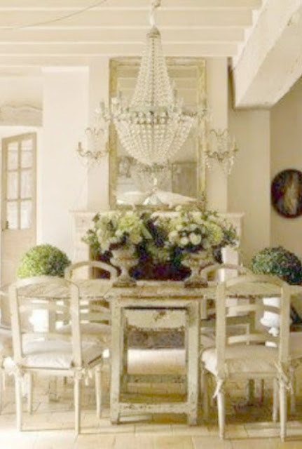 Gorgeous French farmhouse dining room with all white decor and crystal chandelier - Pamela Pierce Designs on Hello Lovely