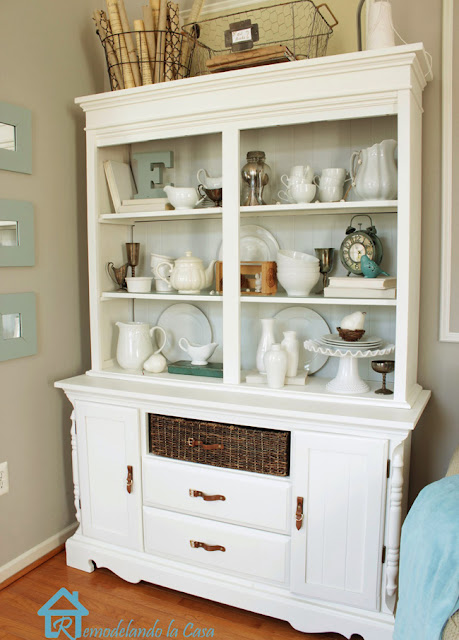 a dark hutch is transformed with moldings and white paint.