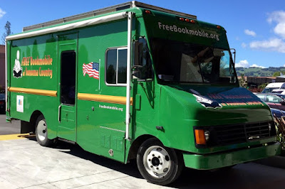 Bright green RV-type vehicle, bearing the slogan, 'FREE Bookmobile of Sonoma County'