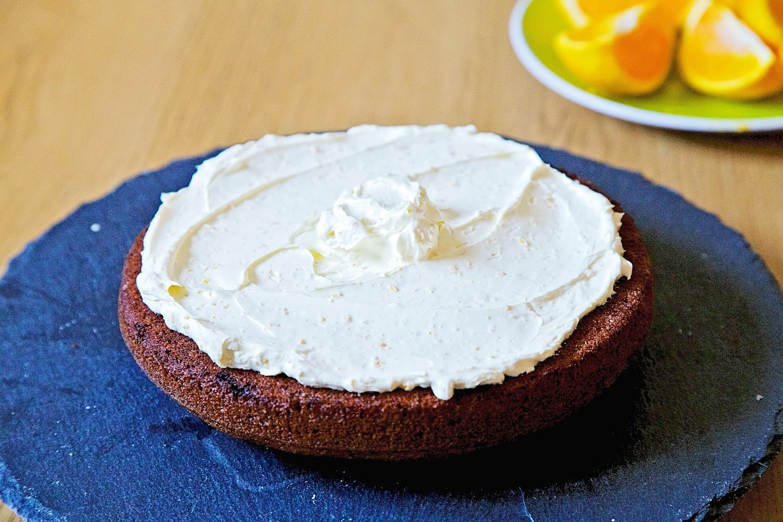 Chocolate cake layer topped with orange whipped cream.