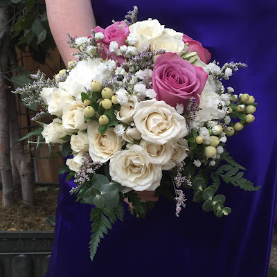 Lavender and white roses bridal clutch bouquet by Stein Your Florist Co.