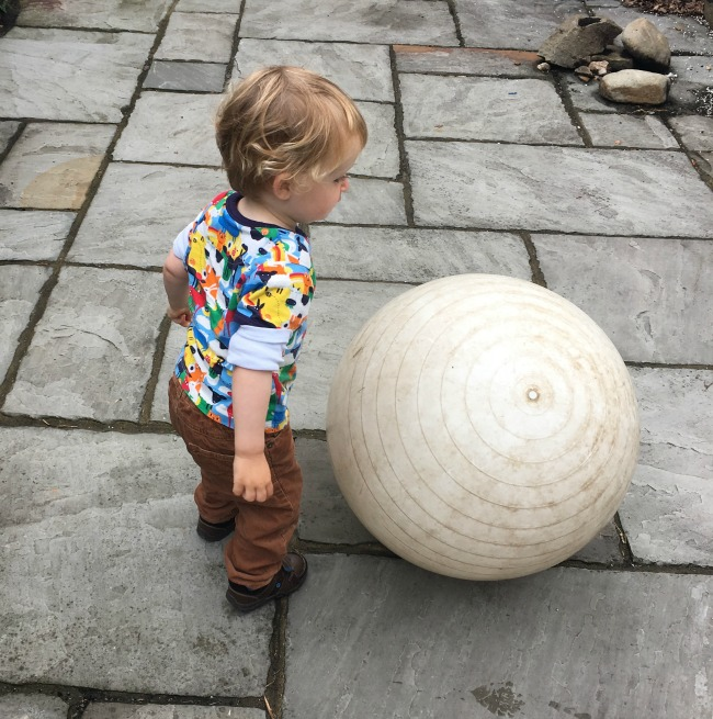 Mini-Breaks-and-Den-Building-toddler-with-huge-ball