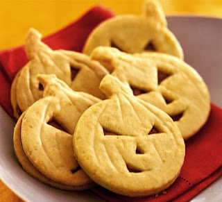http://www.bbcgoodfood.com/recipes/1475/orange-pumpkin-face-cookies