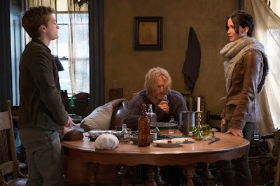Woody Harrelson as Haymitch Abernathy, Jennifer Lawrence as Katniss and Josh Hutcherson as Peeta, in The Hunger Games: Catching Fire, Directed by Francis Lawrence