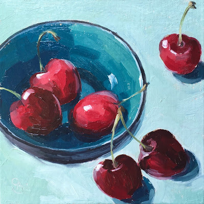 oil painting of 3 cherries in a turquoise bowl, with scatterd cherries around it