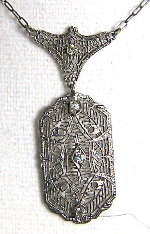 Vintage Art Deco Sterling Silver Filigree Necklace. Via Diamonds in the Library.