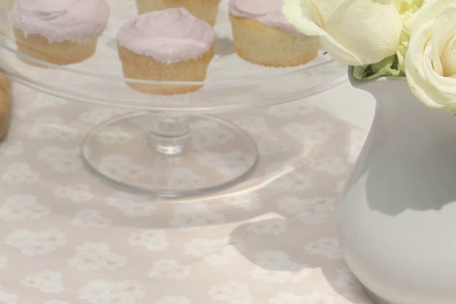 Glass cake pedestal with pink frosted cupcakes - Hello Lovely Studio