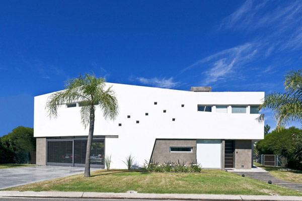 Hogares frescos residencia en forma de v en argentina for Casa minimalista argentina