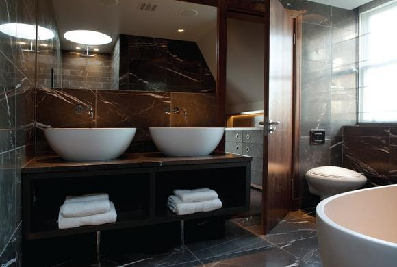 To Da Loos Washrooms With White Bowl Sinks