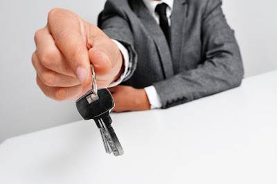 photo of a businessman holding keys