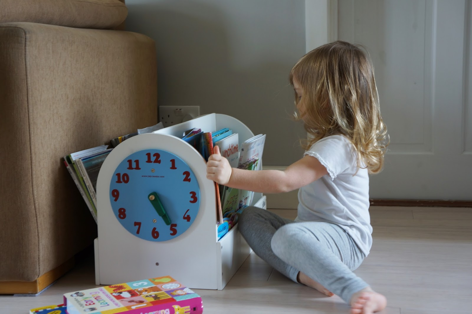 toddler using tidy books box