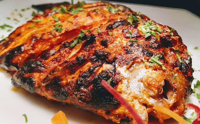 Crisp Golden cooked tandoori Pomfret fish  food recipe dinner ideas