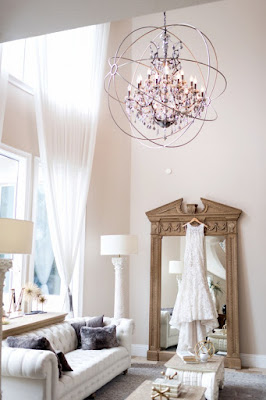 wedding dress hanging with chandelier