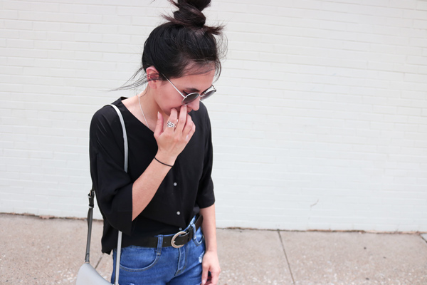Black blouse, vintage belt, blue jeans, top knot, simple hairstyles