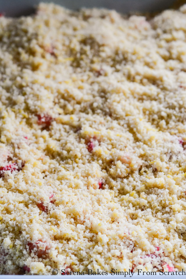Spread Strawberry Rhubarb Cobbler topping over the top of berries.