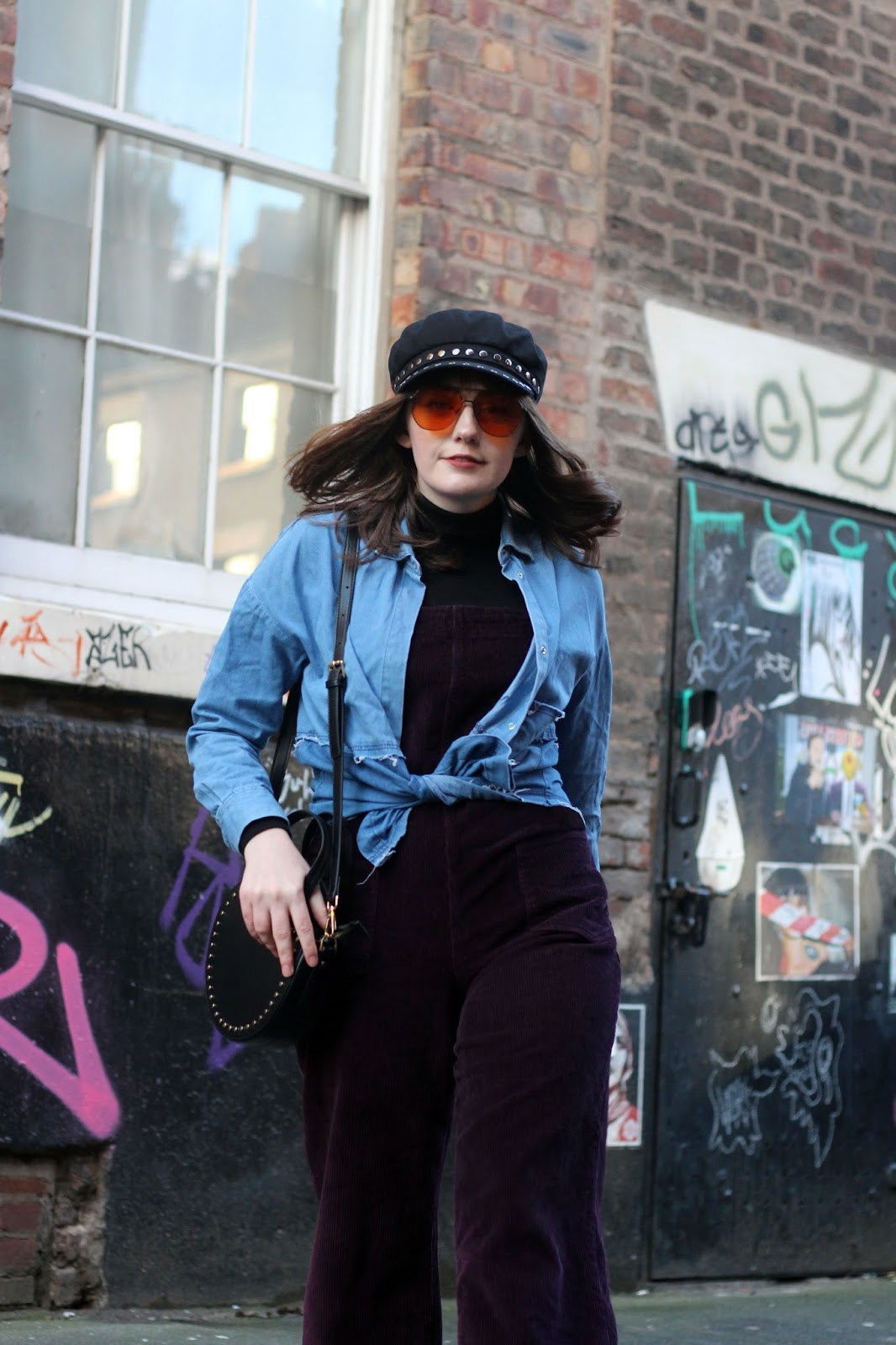 70s inspired street style how to wear dungarees, baker boy, aviators, denim shirt, circle bag