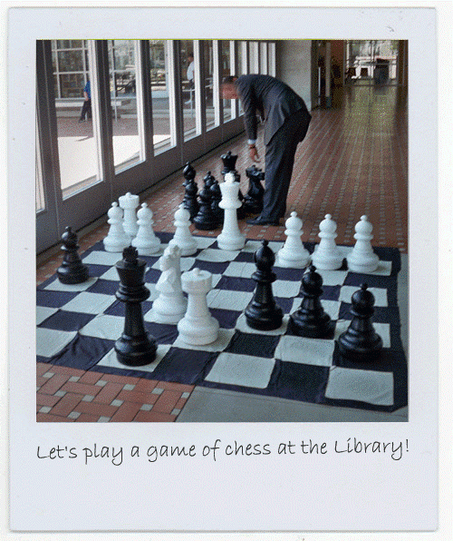 Photograph of one of the officials at the San Diego Central Library playing chess