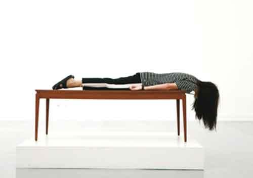 a girl sleep in table