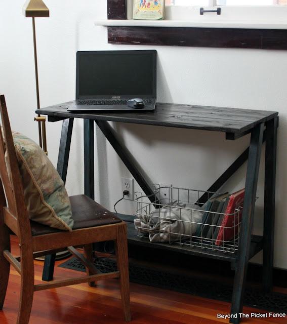 a v brace helps sturdy the rustic desk