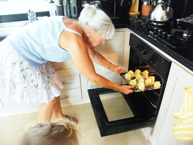 12. Get an adult to help you put the scones in the oven.