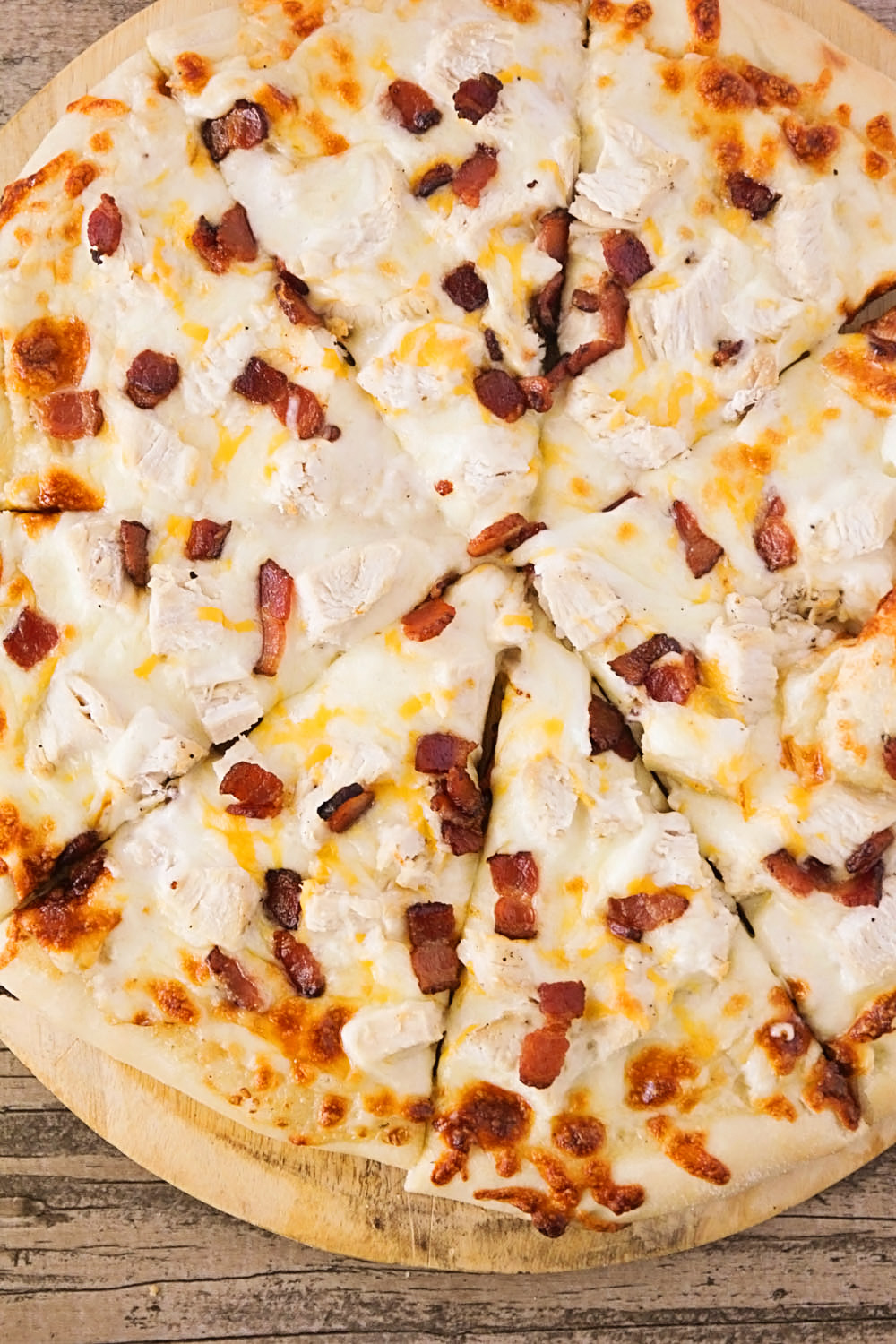 This chicken bacon ranch pizza is so cheesy and delicious, and easy to make too! Perfect for family pizza night!