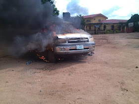 Angry mob attacks ENTRACO office burns down cars, tricycles and building structures.