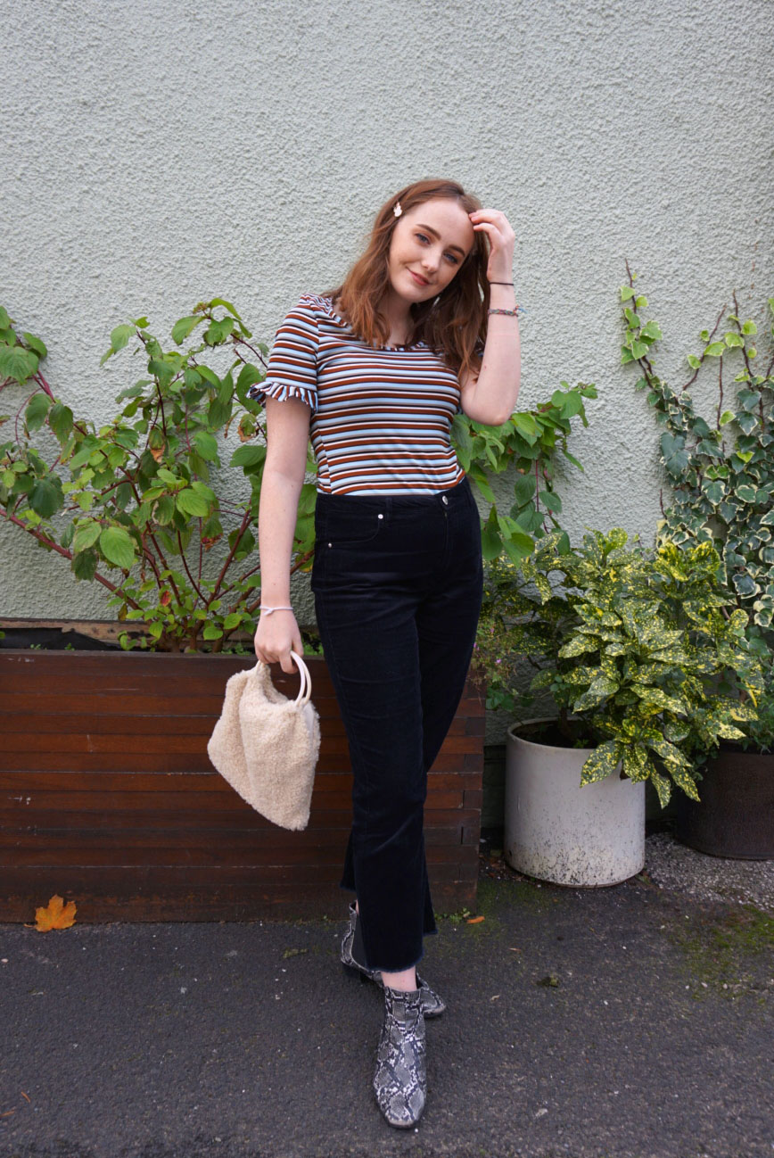 brown, blue, white and black stripe t shirt with frill sleeve, black kick flare cord trousers, both from miss Selfridge