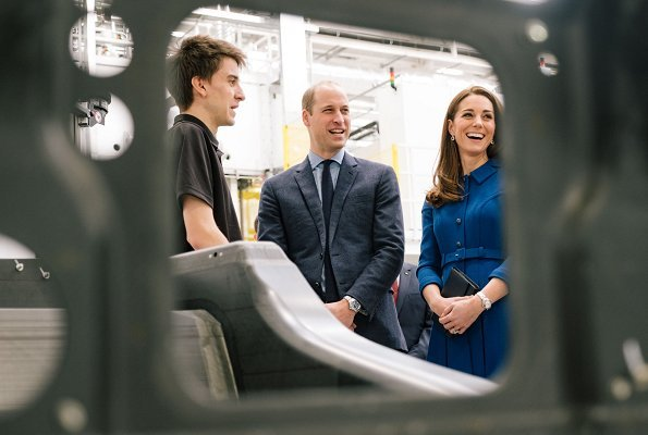 Visit to McLaren, the Duchess wore a blue dress by Eponine, and Rupert Sanderson Malory pumps, a clutch bag by Smythson