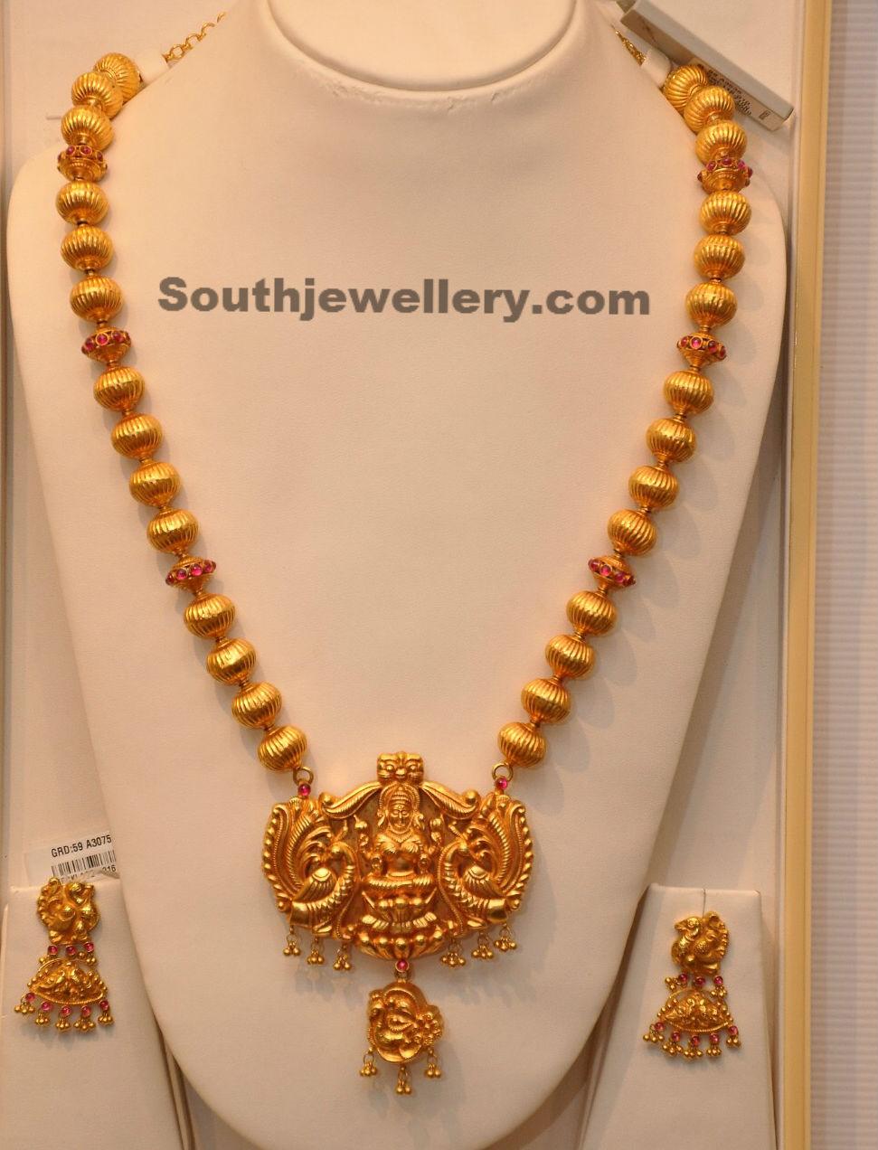 Lakshmi temple long chain jewellery designs for Simple gold ornaments