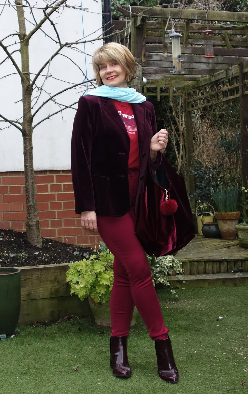 Image showing burgundy velvet jacket styled for casual wear
