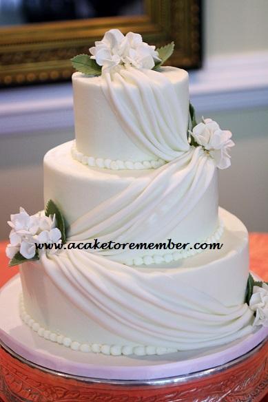 White Draping Wedding Cake