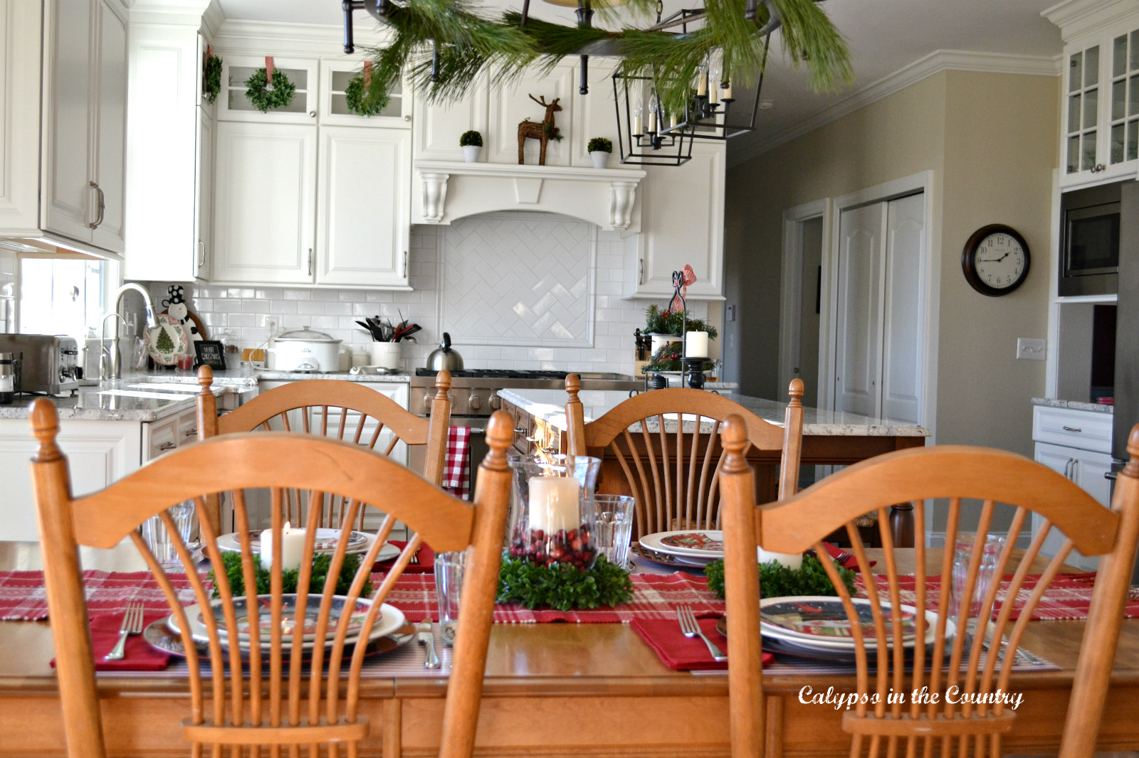 Christmas Table in White Kitchen with mini wreaths