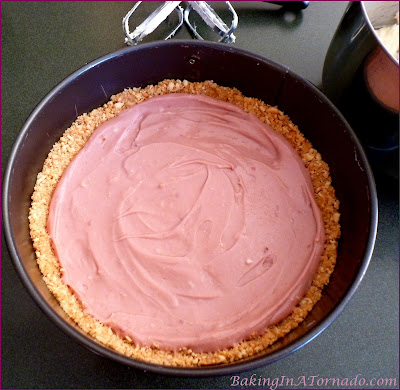 White Chocolate Raspberry Refrigerator Cheesecake, melted white chocolate and fresh raspberries flavor this no-bake cheesecake in a vanilla cookie crust | Recipe developed by www.BakingInATornado.com | #recipe #dessert