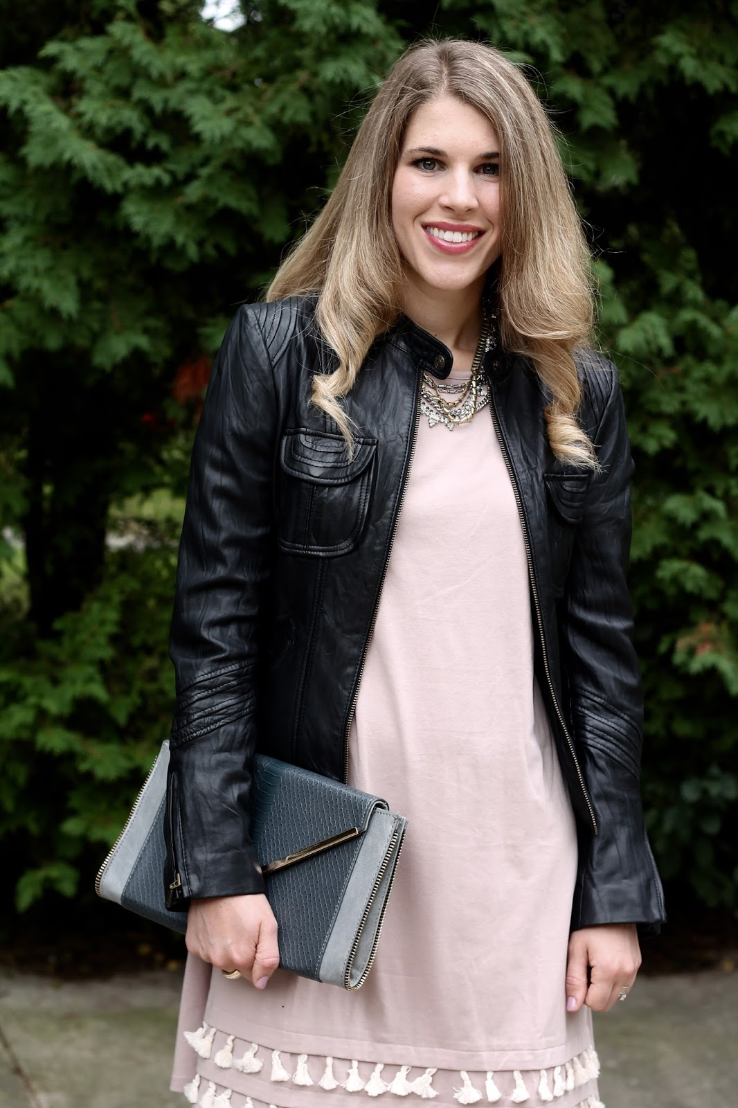 Blush tassel dress, lace up snakeskin heels, grey envelope clutch, black moto jacket,
