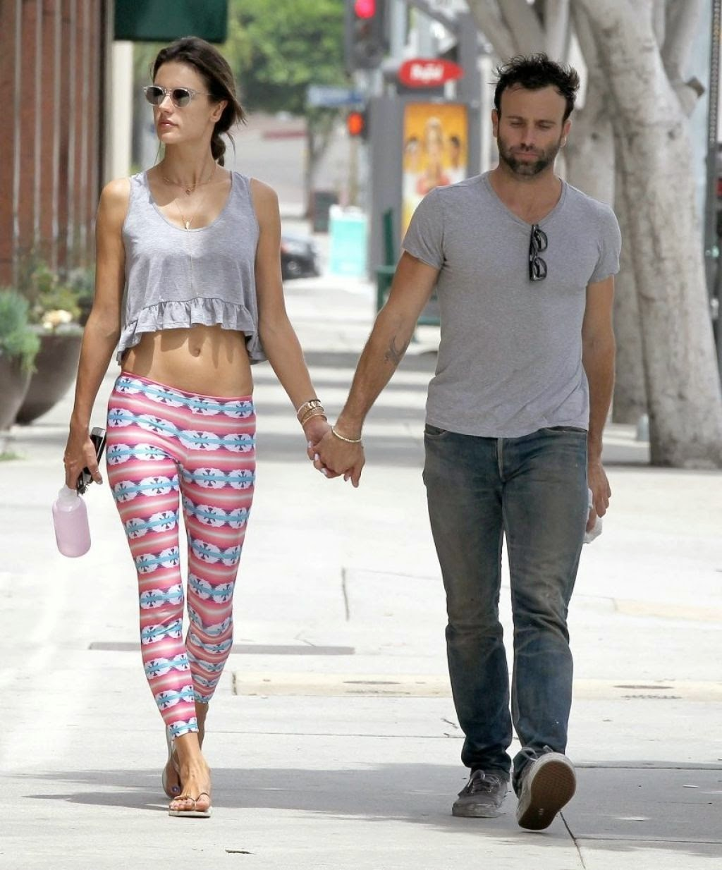 Alessandra Ambrosio is pretty in printed tights and cropped top out and about in Brentwood