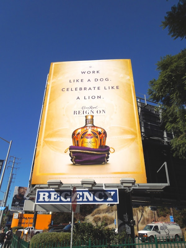 Work like dog Celebrate like lion Crown Royal billboard