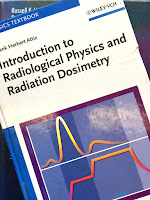 Introduction to Radiological Physics and Radiation Dosimetry, by Frank Herbert Attix, superimposed on Intermediate Physics for Medicine and Biology.