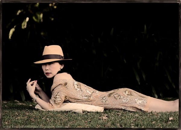 Reclining woman in a hat, fashion blog photographs, blogger and photographer collaboration, Vivienne Shui with Sydney photographer Kent Johnson.