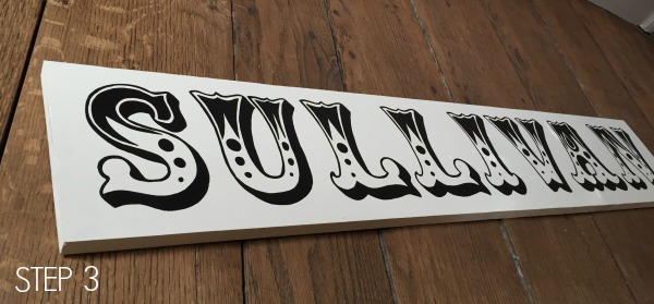 handpainted letters on wood sign