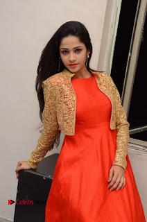 Telugu Actress Divya Nandini Stills in Orange Sleeveless Gown at Chennai Chaitrama Movie le Launch Event  0093.JPG