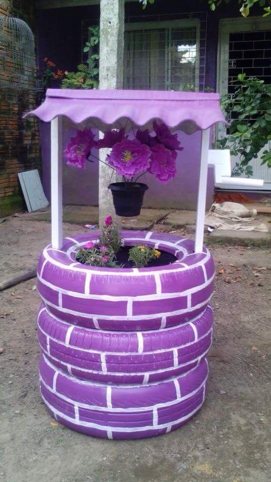 ozdoby z opon dekoracje ogrodowe  studnia kwietnik