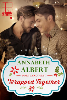 Cover of Wrapped Together, featuring two white men leaning together and smiling, their eyes mostly closed.