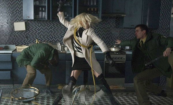 Lorraine (Charlize Theron) uses rubber hose to beat up the Berlin police in ATOMIC BLONDE (2017)