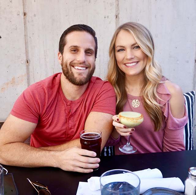 Couple sharing drinks at Mexican Restaurant