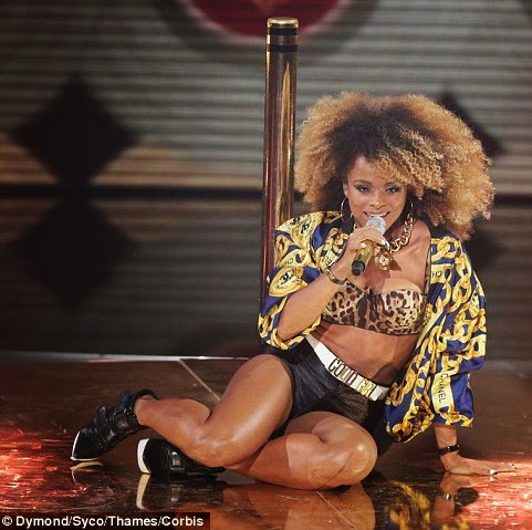 Fleur East Chanel chain detail jacket and black american apparel disco shorts from X Factor 2014 live shows week 2